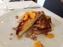 brioche french toast with mandarin orange and granola